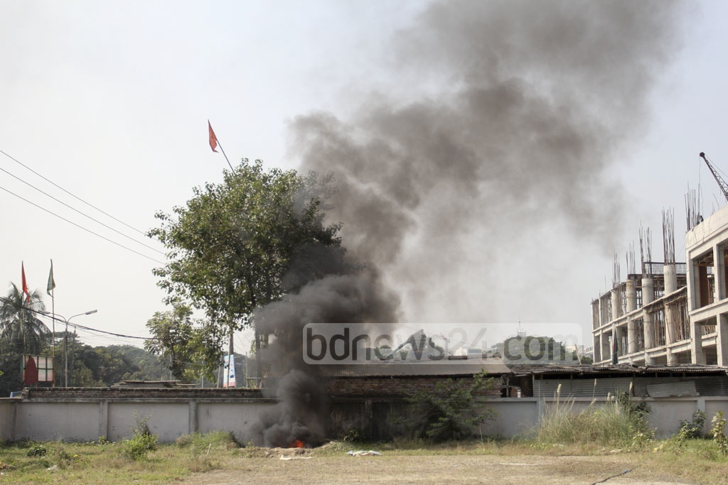 Heavy smoke rises from waste being burnt at the open space before the passport office in Agargaon in the city. The image was snapped on Thursday