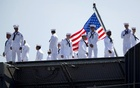 Sailors man the rails as the USS Ronald Reagan, a Nimitz-class nuclear-powered super carrier, departs for Yokosuka, Japan from Naval Station North Island in San Diego, California August 31, 2015. Reuters