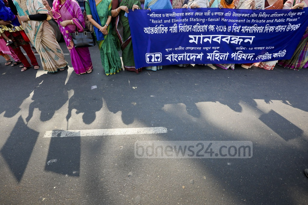 Bangladesh Mahila Parishad holds a human chain programme in front of the National Press Club on Friday against all forms of abuse suffered by women and female children. Photo: asaduzzaman pramanik