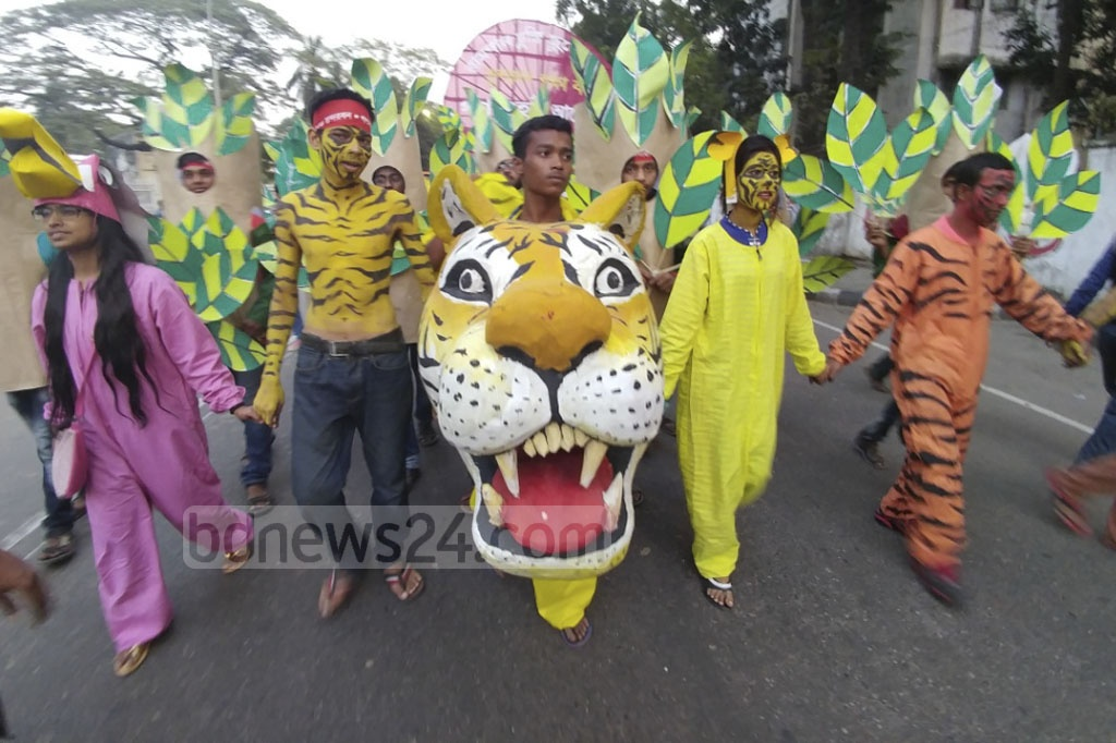 Some protesters paint themselves with triger stripes at the rally organised on Saturday in Dhaka to say no to Rampal power plant project near the Sundarbans. Photo: abdul mannan