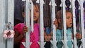 Children look through the locked collapsible gate of 'Shishu Mela', a children's amusement park in Shyamoli, after it was shut down on Saturday for non-payment of lease rent for over a decade. Photo: asaduzzaman pramanik