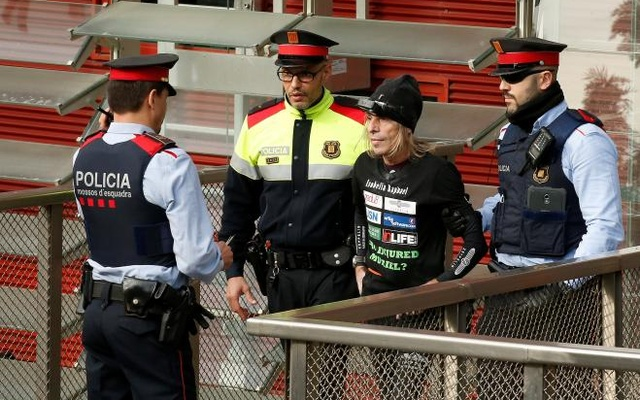 Alain Robert is detained by police after he scaled the skyscraper. Reuters