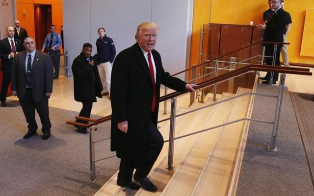 US President-elect Donald Trump walks up a staircase to depart the lobby of the New York Times building after a meeting in New York, US, November 22, 2016. Reuters