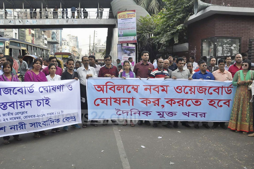 Journalists take out a march outside the National Press Club on Sunday to press authorities into announcing the Ninth Wage Board.