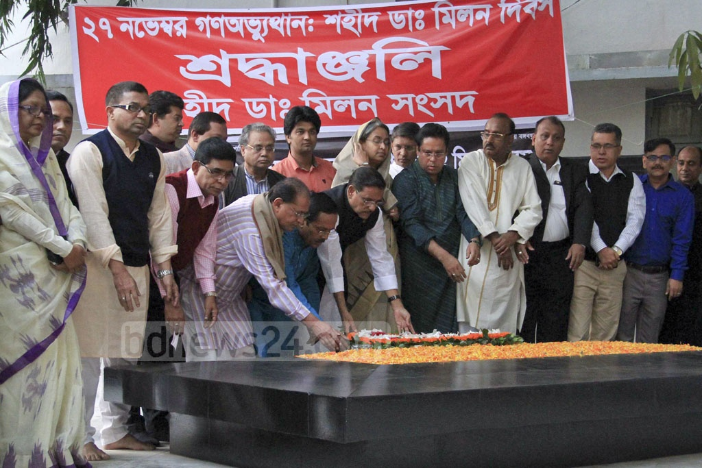 Leaders of the ruling Awami League place flowers on the grave of Dr Shamsul Alam Khan Milon at Dhaka Medical College Hospital premises on Sunday, the death anniversary of the man martyred during the 1990 movement against autocracy.