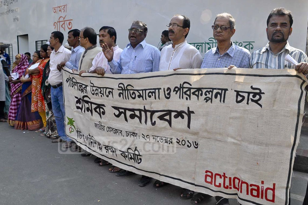 Activists demand regulation and planning for the development of jute industries by holding demonstration outside the National Press Club on Sunday.