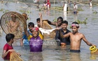 Celebrations are on after catching a 'big' fish as hundreds of people took part in 'Palo Bawa', a fishing festival, at Barhaibarhi Bil in Gazipur's Kaliakoir on Saturday. Photo: mostafigur rahman