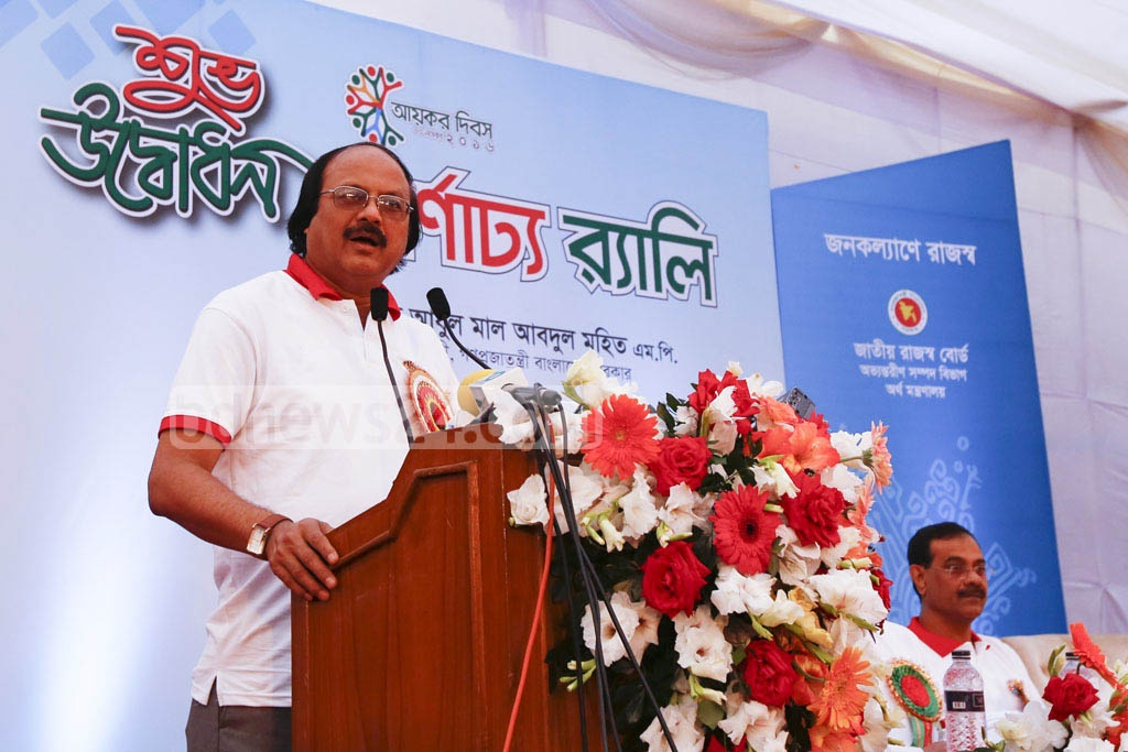 National Board of Revenue Chairman Nojibur Rahman speaks at a rally in Dhaka's Segunbagicha on Wednesday before the begining of a procession to mark National Income Tax Day 2016.