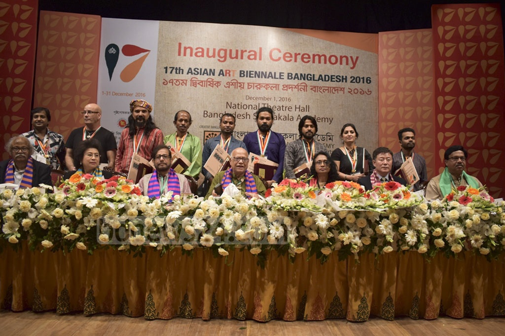 Award-winning artists pose for a group photo with the guests at the 17th Asian Art Biennale Bangladesh 2016 at the Shilpakala Academy in Dhaka on Thursday.