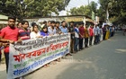 A human chain outside the Gopalganj Press Club protests the attacks on Hindus at Nasirnagar and the eviction of Santals at Gobindaganj on Friday.