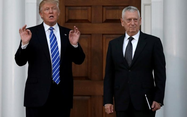 U.S. President-elect Donald Trump stands with retired Marine Gen. James Mattis following their meeting at the main clubhouse at Trump National Golf Club in Bedminster, New Jersey, U.S., November 19, 2016. Reuters