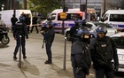 French police secure a street near the travel agency where a gunman has taken hostage about half a dozen people in what appears to be a robbery, a police source said, in Paris, France, December 2, 2016. Reuters