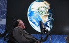 Physicist Stephen Hawking sits on stage during an announcement of the Breakthrough Starshot initiative with investor Yuri Milner in New York April 12, 2016. Reuters