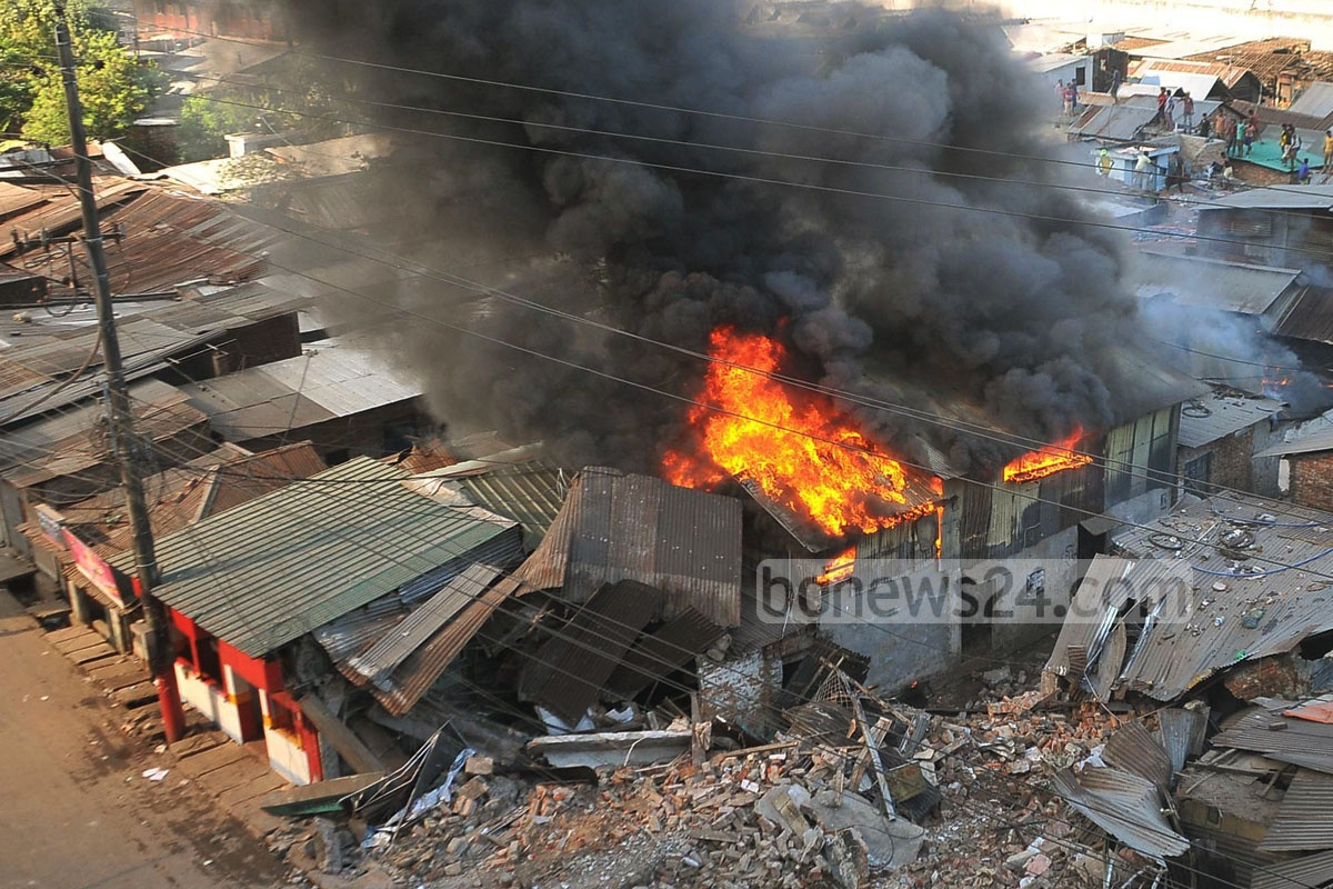 A fire erupted at a slum in Chittagong on Sunday when railway authorities conducted a drive to evict it. Photo: suman babu