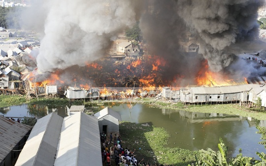 A fire raged through Dhaka's Karhail slum on Sunday, nine months after it was ravaged by one. Photo: asif mahmud ove