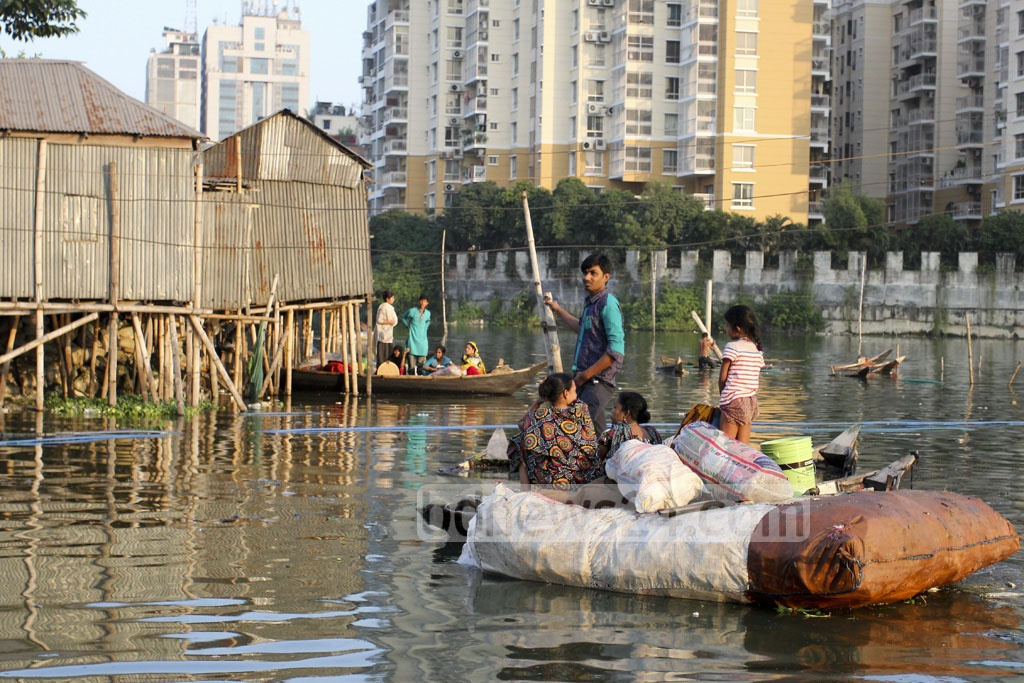 Residents of Karhail slum in Dhaka's Mohakhali area are taking their household belongings to safety after a fire broke out in the slum Sunday afternoon.