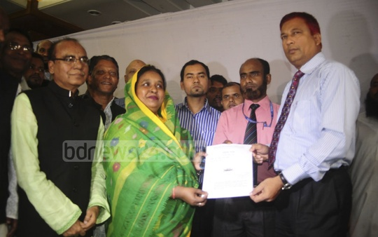 Awami League candidate Selina Hayat Ivy is handed the ruling party's 'boat' symbol by the returning officer at Narayanganj on Monday. Photo: asif mahmud ove