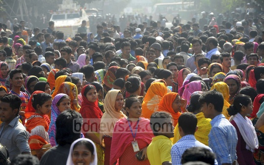 Garment workers block a road in Mirpur on Monday to protest a factory's decision to move to Gazipur.