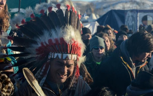 People celebrate in Oceti Sakowin camp as 'water protectors' continue to demonstrate against plans to pass the Dakota Access pipeline near the Standing Rock Indian Reservation, near Cannon Ball, North Dakota, US Dec 4, 2016. Reuters