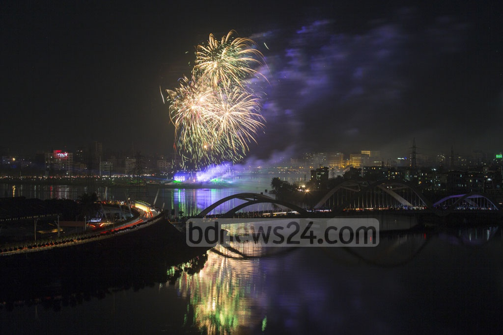 Laser show light up the night sky of Hatirjheel in Dhaka during a festival of lights to celebrate the milestone of reaching 15,000 megawatt power generation capacity.