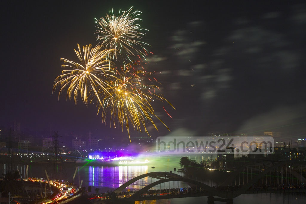 Spectacular fireworks accompanied by laser show light up the night sky over Hatirjheel in Dhaka during a festival of lights to celebrate reaching 15,000 megawatt power generation capacity.