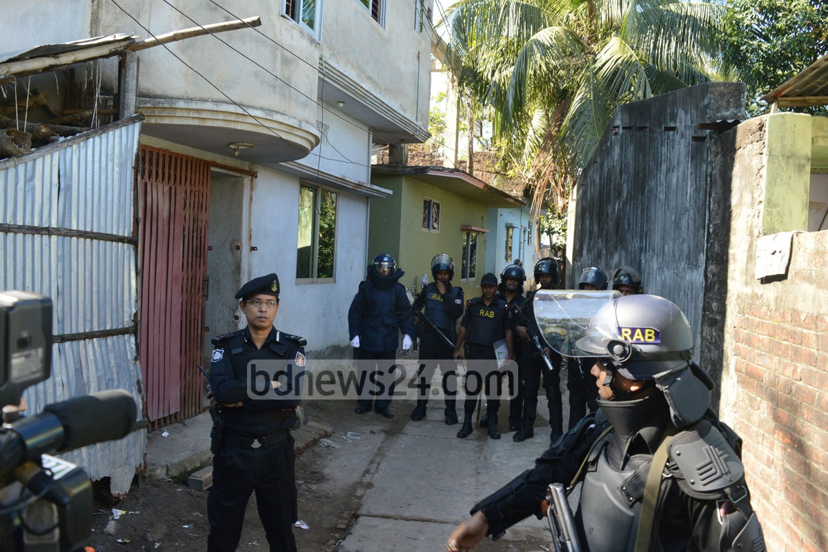 RAB raided this house at Chittagong's Colonel Haat on Thursday, which they say was used as a hideout of Harkat-ul-Jihad (HuJI) militants. Photo: suman babu