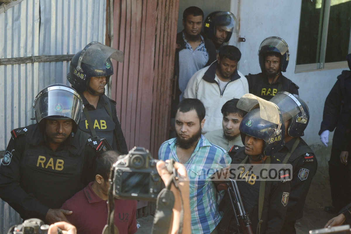Suspected Harkat-ul-Jihad (HuJi) militants taken into custody following RAB raid at hideout in Chittagong's Colonel Haat on Thursday. Photo: suman babu