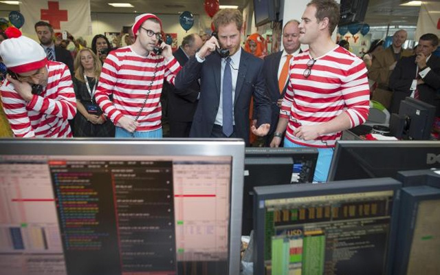 Britain's Prince Harry takes part in a charity trading day at ICAP on the Aus/Nz forwards Desk with Jack O'Brien and Phil McMahon in support of his charity Sentebale, in London, December 7, 2016. Reuters