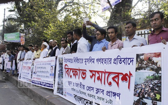 People protest against persecution of Rohingyas in Myanmar outside the National Press Club in Dhaka.
