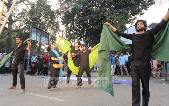 Bangladesh Street Theatre Council staged a drama against militancy and oppression of women and children in front of the National Museum in Dhaka on Friday.