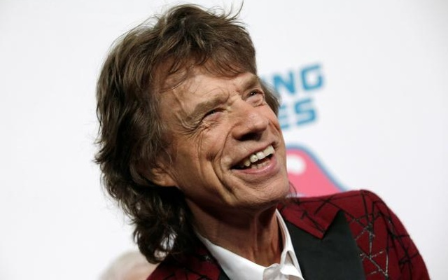 Mick Jagger of The Rolling Stones poses for photographers as the band arrives for the opening of the new exhibit ''Exhibitionism: The Rolling Stones'' in the Manhattan borough of New York City, US, November 15, 2016. Reuters