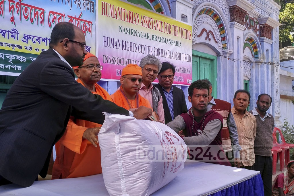 Aid distributed to the victims of attacks on Hindus in Brahmanbarhia's Nasirnagar by the Nasirnagar Ramkrishna Asram with funds from the Human Rights Centre for Bangladesh at the local Duttabari premises on Saturday.
