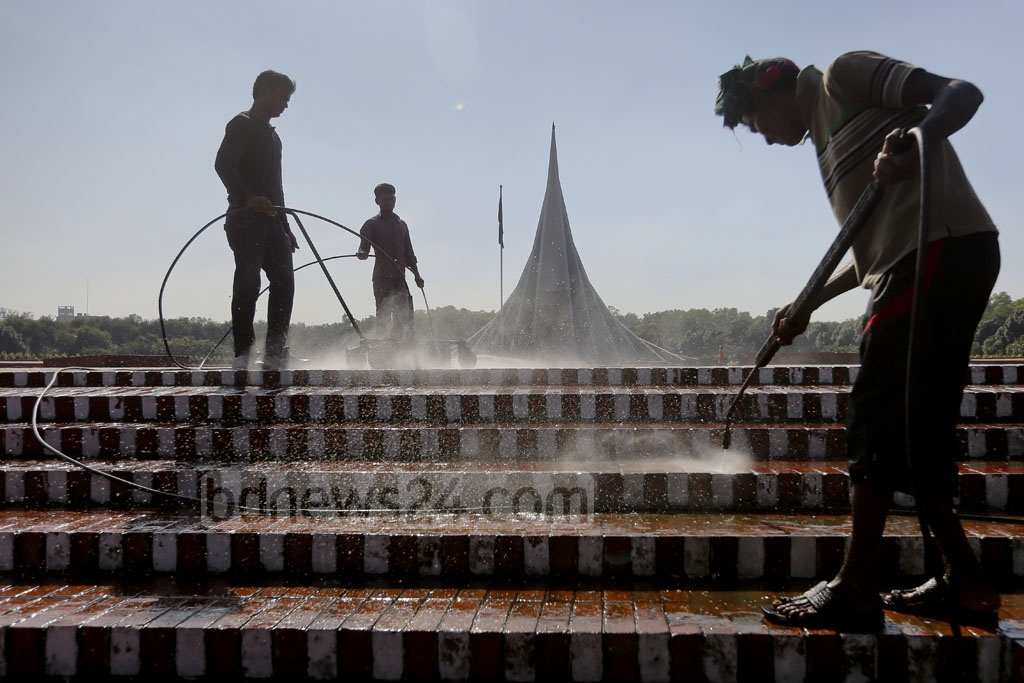 Workers clean the National Memorial at Savar ahead of the Victory Day celebrations. Photo: asaduzzaman pramanik