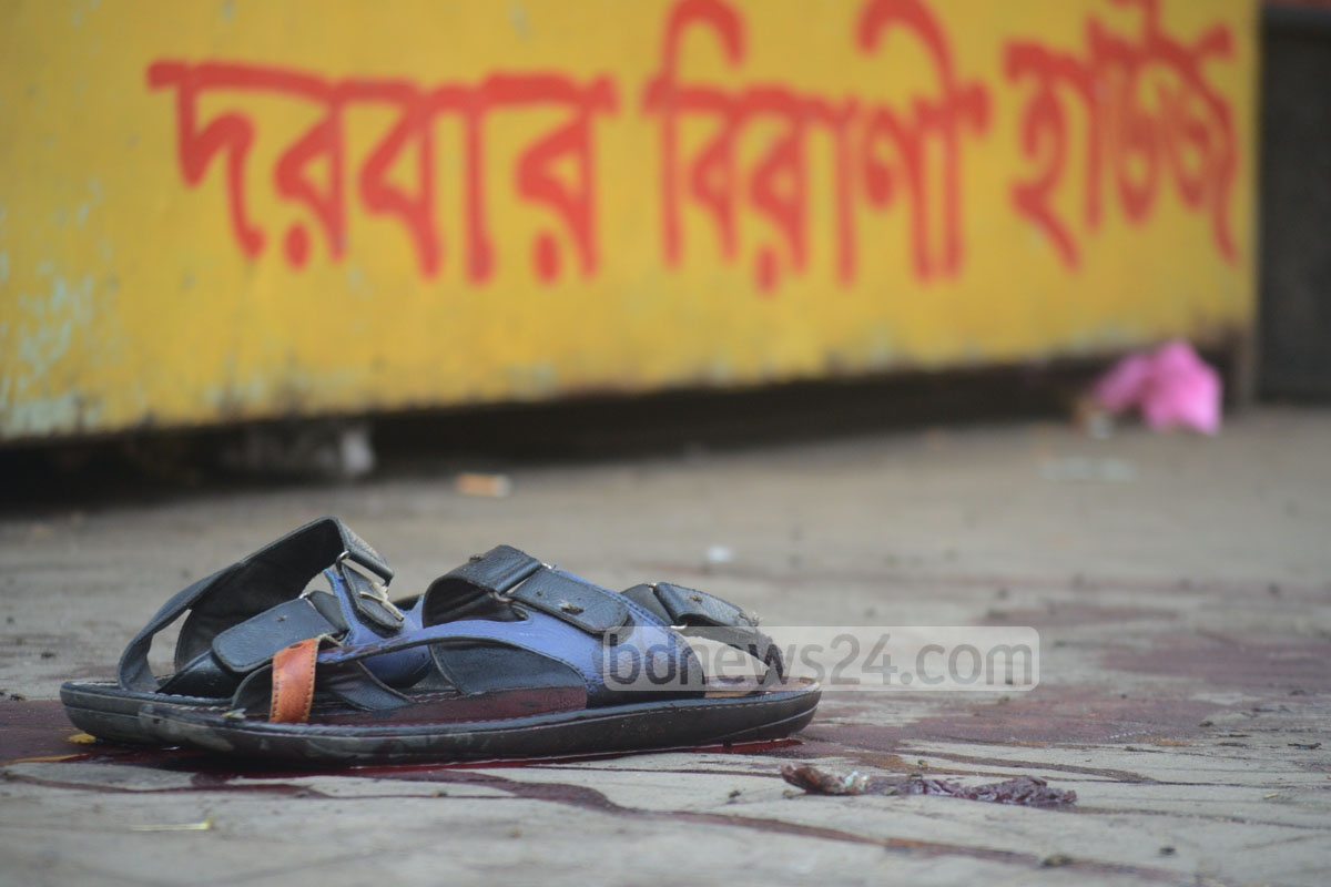 A crime scene is being processed in Chittagong after the fatal daylight shooting of a man near the Kotwali Police Station in the port city on Sunday. Photo: suman babu