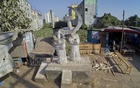 Illegal structures surround a monument dedicated to Rana Plaza victims at Savar. Photo: asaduzzaman pramanik