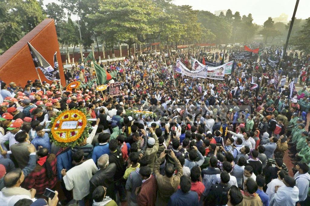 People flock to the Martyred Intellectuals Memorial at Mirpur in Dhaka on Wednesday to pay homage to the martyred intellectuals.