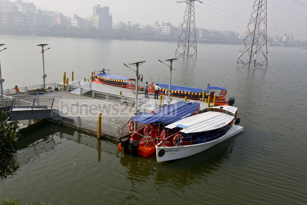 Water taxis, the newest addition to public transport in Dhaka, will start ferrying passengers on the Hatirjheel Lake from Friday. Photo taken on Thursday from landing point at the Badda Link Road end of the lake. Photo: mostafigur rahman