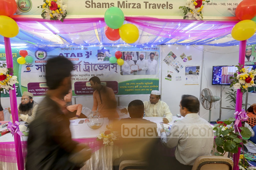 Visitors at a stall at the Hajj and Umrah Fair in Bangabandhu International Conference Centre on Thursday. Photo: asaduzzaman pramanik