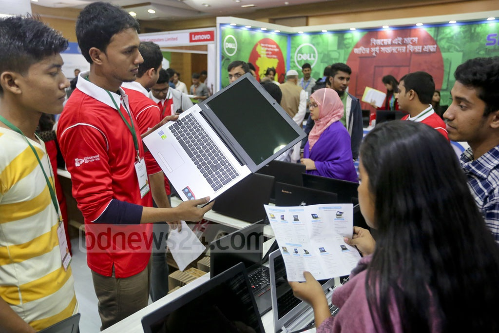 Staff member answering queries from the visitors at the Laptop Fair that began at the Bangabandhu International Conference Centre on Thursday. Photo: asaduzzaman pramanik