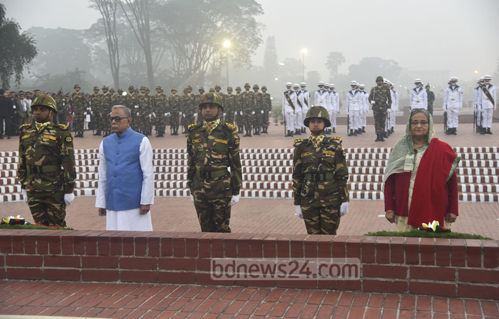 President Abdul Hamid and Prime Minister Sheikh Hasina pay tribute to 1971 Liberation War martyrs at the National Memorial in Savar on the Victory Day on Friday.