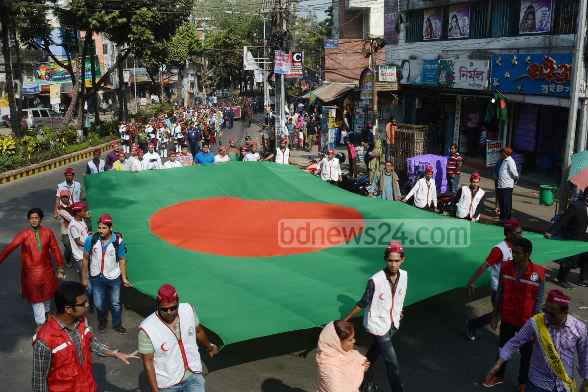 A march is taken out at Chittagong's M A Aziz Stadium area to celebrate Victory Day on Friday. Photo: suman babu