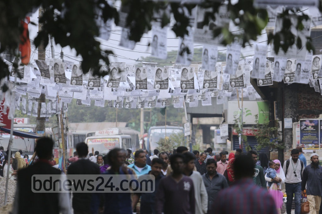 Streets of Narayanganj city are covered with posters of rival candidates ahead of the City Corporation elections to be held on Dec 22. The picture is taken from Narayanganj Ghat area on Saturday. Photo: asaduzzaman pramanik