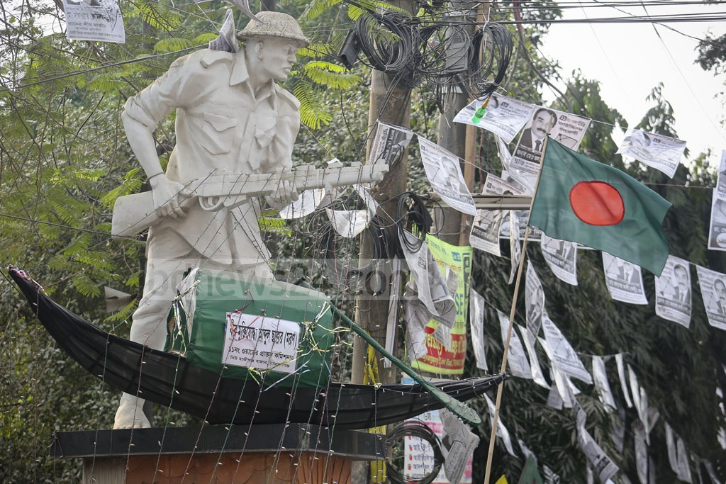 Campaign signs and posters for the Narayanganj City Corporation elections deface a national memorial for the 1971 war heroes. Picture taken on Saturday at the city's Hajiganj area. Photo: asaduzzaman pramanik