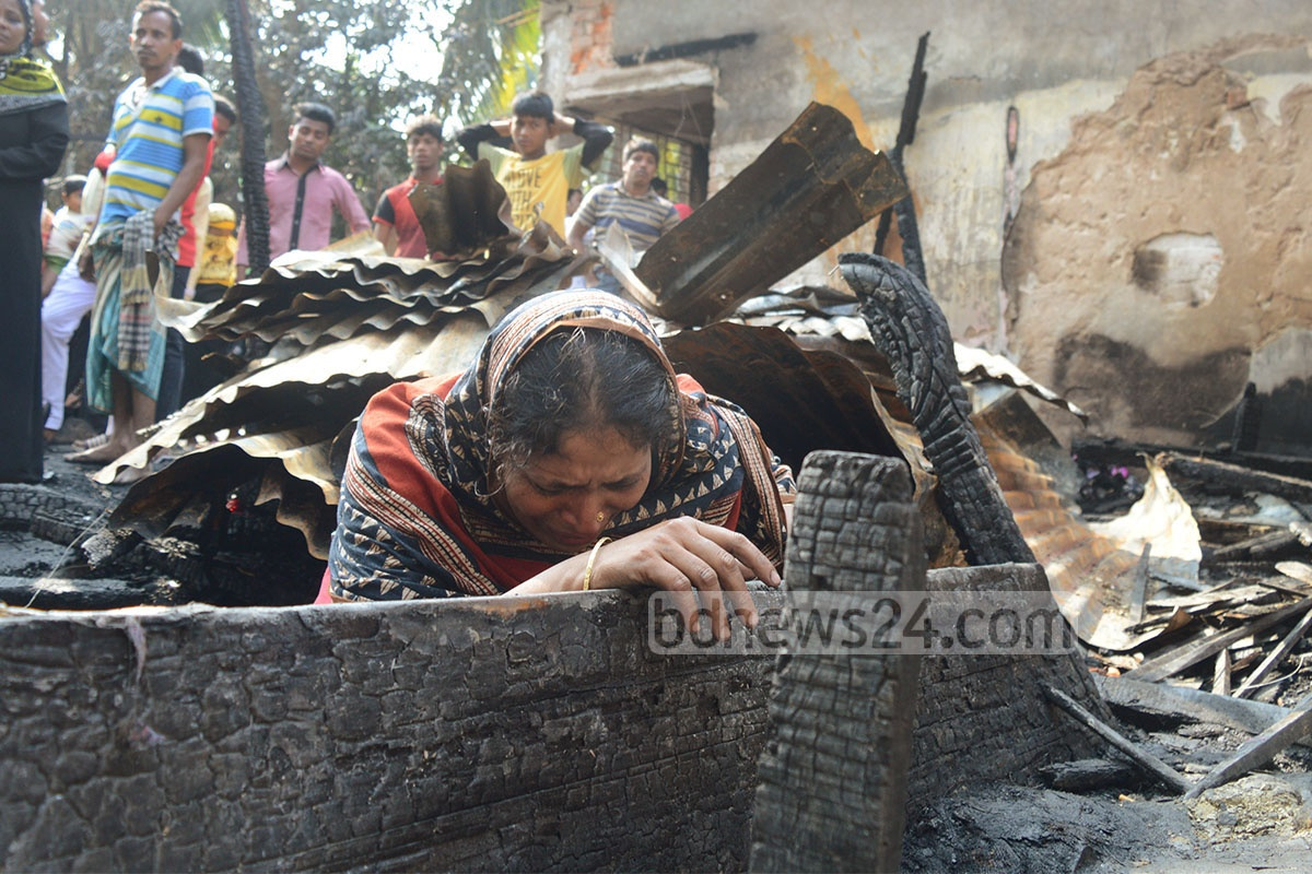 Victims at the remains of their burned down house in Chittagong's Bakolia Bolirhaat area on Sunday. Photo: suman babu