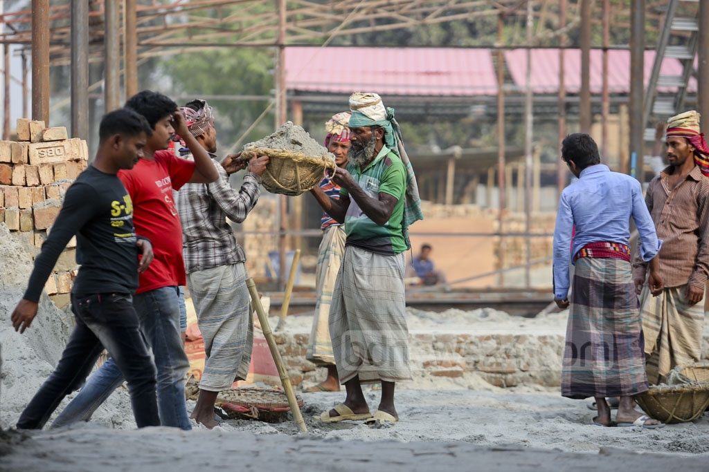 Busy labourers working to put up structures at Dhaka International Trade Fair premises on Tuesday. Photo: asaduzzaman pramanik