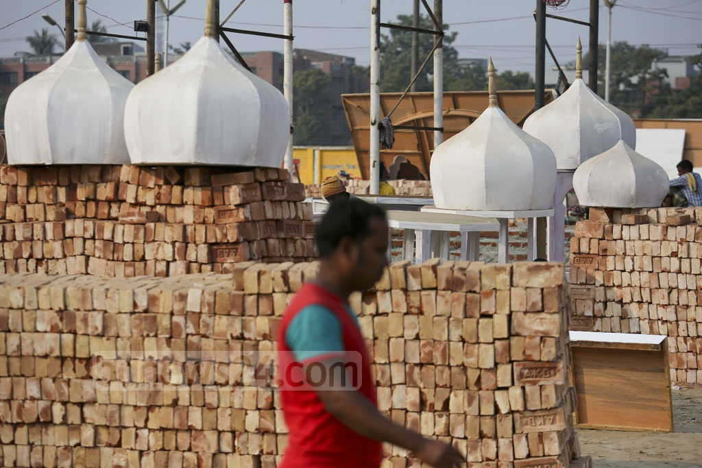 These wooden domes will complete the design for Dhaka International Trade Fair's main entrance. Photo: asaduzzaman pramanik