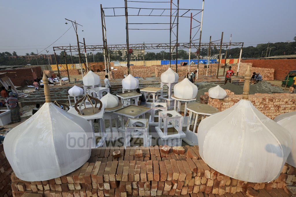 Domes of cardboard wait to be painted and installed on the main entrance to Dhaka International Trade Fair. Photo: asaduzzaman pramanik