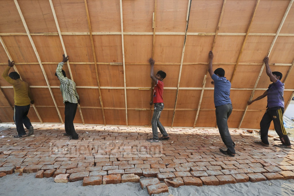Labourers work on the site at Dhaka's Sher-e-Bangla Nagar where Dhaka International Trade Fair will be held in January. Photo: asaduzzaman pramanik