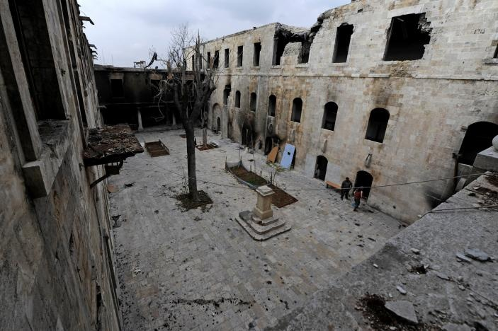A general view shows damage in al-Sheebani school's courtyard, in the Old City of Aleppo, Syria December 17, 2016. Reuters