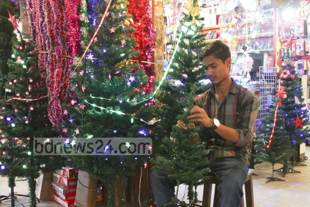 A trader prepares a Christmas tree at Dhaka's Farmgate on Wednesday. Photo: abdul mannan